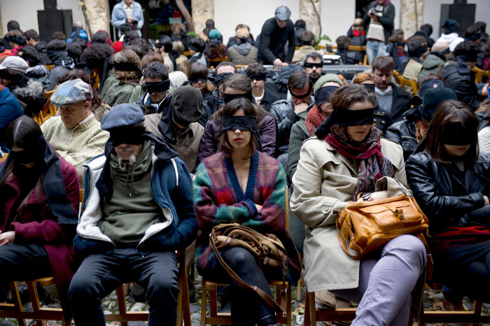 Audience with blindfolds at a Francisco Lopez concert. Image from www.bienaldegranada.com